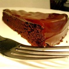 Flourless Chocolate Cake II  For THM Use unsweetened baker's chocolate instead of semi-sweet & Use 1 1/4 cups Truvia, xylitol, or combo of both We didn't put anything on top, it didn't need it!