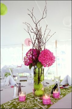 Alternating Pink And Green Table Linens Were Topped With Tea Lights Cylinders Filled Apples Hydrangeas Tulips Peon