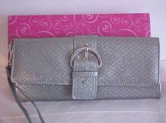 "Mundi Glitter Snake Silver Buckle Wristlet Silver faux Snake pattern Patent leather, Silver tone Buckle and studs on front, Push button closure, Back zipper pocket, ID photo slot, 4 Card slots ,middle zipper pocket  measures approx. 8 3/4"" x 4"" x 1"""