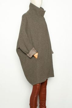 Corrugated Cocoon Coat. This coat and it's rounded, sloped shoulders and loose fit is best with dresses or skinny pants. Volume and proportions must be right.