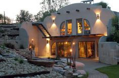 """Although not a true """"Earthship,"""" I love the combination of earth sheltered/off grid as well as beauty. Form + Function. Just because it is functional doesn't mean it has to be ugly!"""