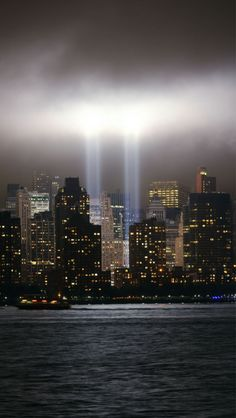"""sevvven: """" ALWAYS REMEMBER THAT DAY IN SEPTEMBER. The Tribute in Lights is an art installation of 88 searchlights placed next to the site of the World Trade Center to create two vertical columns of..."""