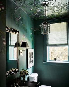 """""""I believe that every powder room should be a jewel box,"""" says designer @hillarythomas of the formerly dark space in her S.F. home, which """"just needed pizzazz."""" She achieved this with the use of lavender-and-silver @degournay wallpaper and a custom eglomise ceiling: """"The ceiling is a surprise, and we had @willemrackéstudio continue the De Gournay design onto the glass."""" Of the Charles Edward Pagoda sconce, she says, """"I love to include a little Asian flair; the unexpected details are always…"""