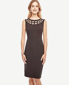 """Sleek cutouts punch up the wow-factor of our slim sheath, giving it standout status. Boatneck. 25 3/4"""" from natural waist."""
