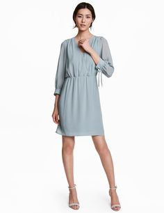 Check this out! Short dress in woven fabric. Wrapover front section with covered button, decorative gathers at shoulders, 3/4-length sleeves, and narrow cuffs with tie. Elasticized seam at waist. Lined. - Visit hm.com to see more.
