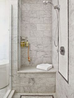 I like the idea of a bench/sitting area in the shower. Not a fan of the tiles.