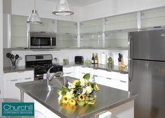 Sleek & modern kitchen with stainless steel appliances and kitchen island