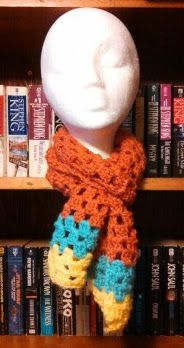 Awesome crocheted scarf with orange yellow and blue yarn. Super warm and cozy!