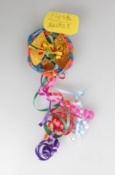 "2012 Original Fiesta Medal - Best Kid's Medal ""Fiesta Nachos"" by Elise Gellhausen, age 9 (Juanito M. Garza / San Antonio Express-News) / SA"