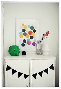 replicate picture with cut out paper circles and glue to paper as activity.  Frame & hang in room.