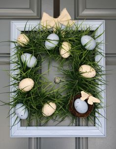 Square Grass wreath - spray paint and speckle plastic Easter eggs.