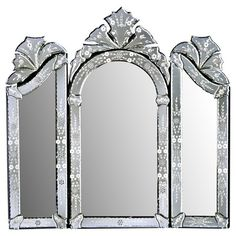 Cut, beveled, and etched by hand, this Venetian-style wall mirror brings rich detail and beautiful craftsmanship to your walls.  Pro...