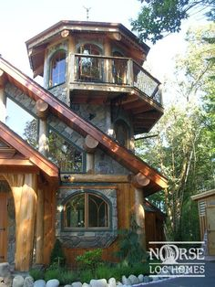 Stone and log cabin lighthouse. An odd but intriguing melding of styles that gives lots of interior lighting and a great view of the outdoors landscape. -DdO:) > http://www.pinterest.com/DianaDeeOsborne/intriguing-architecture - photo source: Norse Log Homes ~ the Tower