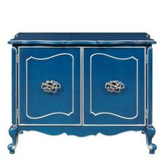 This stunning Jordan bar cabinet is the color of a sapphire martini. The shaped top, cabriole legs, polished chrome hardware and silver-painted accents up the glamour quotient. The inside of the cabinet, painted a complementary hue of blue features astemware rack and an adjustable rack/shelf for wine or liquor bottles. Go head, pour another.