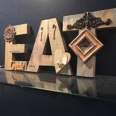 rustic wood EAT sign, kitchen wall decor, chunky wood EAT letters, word art, kitchen decoration, gift for cook, chef, metallic kitchen art by Bedotted on Etsy