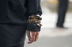 Bracelets worn over the sleeve as seen at New York Fashion Week | Photo by Wataru Bob Shimosato / An Unknown Quantity #streetstyle