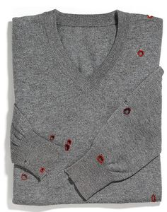 Add some button hole stitches to a sweater the moths dined on.