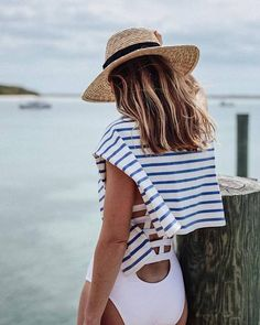$190 Neutra Strappy-Back One-Piece Swimsuit Teamed With $95 Vince Stripe Boat Neck Pullover And $44 Brixton Straw Hat