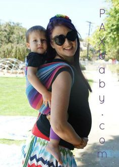Here are some tips for babywearing while pregnant from PAXbaby.com: #1 - Confirm with your midwife/ doctor that you don't have a medical issue that would prevent you from safely babywearing during pregnancy. #2 - If you feel any pain while or after babywearing, be sure to let your midwife or doctor know. #3 - Use a supportive baby carrier that is appropriate for the child you are wearing. ...cont...