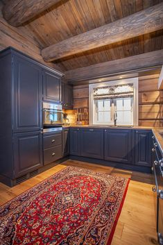 Discover recipes, home ideas, style inspiration and other ideas to try. Small Cabin Kitchens, Log Home Kitchens, Rustic Kitchen Cabinets, Kitchen Cabinet Styles, Wood Paneling Decor, Open Plan Kitchen Living Room, Cabin Interiors, Cool House Designs, Log Cabin Homes