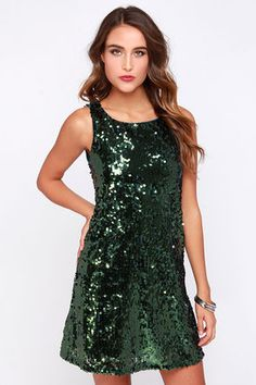 It's impossible not to smile and enjoy an amazing evening in the Having a Ball Olive Green Sequin Dress! Catching the light for a sparkling display, countless olive green sequins cover this sheath dress from its rounded neckline and sleeveless bodice, down to a flirty skirt at bottom. A keyhole cutout at back is joined by a mother of pearl button closure. Fully lined in teal stretch knit. 100% Polyester. Hand Wash Cold. Imported.