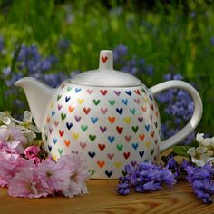 A truly romantic teapot covered in multi-coloured hearts all hand painted. Perfect for special tea parties with best friends and loved ones. Go on, spoil someone special.  This teapot can also be personalised, this is available on my website.  Teapot is 23cm length (inc handle) x 15cm height x 15cm width. Capacity 1 litre. 35 fl.oz. approx. 4 cups or 3 mugs.  My ceramics are made from earthenware clay, painting and glazing in lead free glazes. Each ceramic piece that I sell really is…