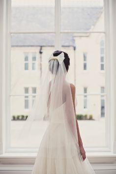 Long finger tip veil with detachable sequin bow