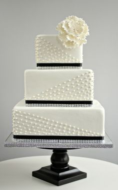 Black and white square wedding cake with sugar beading and sugar flower.