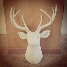 Ski Lodge Decor - White Faux Taxidermy over fireplace mantel