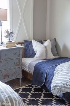 Navy and Ticking Boys Room. For a similar bedspread try: https://www.naturalbedcompany.co.uk/product/large-cotton-waffle-throws/