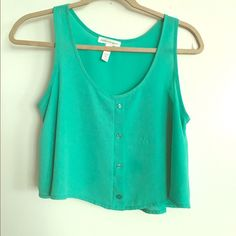 Teal Sheer Chiffon Crop Top Perfect sheer crop top for layering! Cute teal or Aqua color. Buttons down the middle. Hardly worn. Considering all offers. Will not sell off Poshmark. Tops Crop Tops