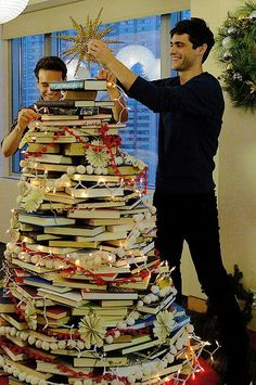 Christmas tree made of books by Simon and Alec. I want this tree with Alec next to it for Christmas thanks