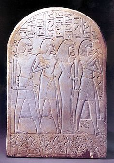 Iuffer-bak, guardian of the storehouse of the Temple of Amun, with his wife and two sons in the central portion of the stele . Egyptian 18th Dynasty stele from Thebes.