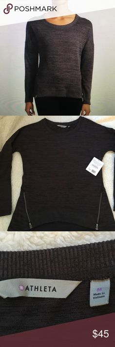 ATHLETA  new with tag sweatshirt blissful sharkbit Brand new, with tags!! An Athleta favorite, sporty Tecce sweat with a high low hem and front zips for mobility, crewneck for extra breathing room, raglan sleeves give you room to move, rib knit trim along cuff and hem.  It is lightweight smooth stretchy, super soft, with breathable fabric. Athleta Tops Sweatshirts & Hoodies