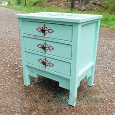 Plans to build a Monterrey side table featuring three drawers and plenty of storage!