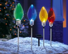 Giant bulb outdoor christmas lights ornaments holidays pinterest set of 4 solar christmas light bulb garden stakes mozeypictures Images