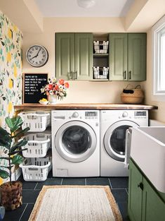 Green Paint Colors Our Editors Swear ByStep away from white cabinets and into something a little more colorful. In this laundry room, muted forest green cabinets pair with an eclectic mix of wood and Laundry Room Remodel, Laundry Room Storage, Laundry Room Design, Laundry Room Colors, Basement Laundry, Colorful Laundry Rooms, Laundry Room Island, Small Laundry Rooms, Küchen Design