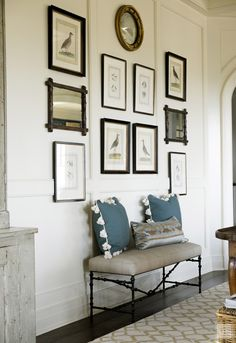 Gallery wall with bench - From the Portfolio of Tammy Connor Interior Design