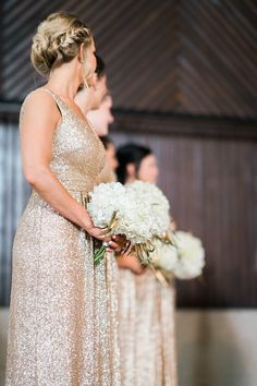 These sequined gold dresses were just the right amount of sparkle for the @brooklynartsnc stage.  Simple hydrangea bouquets with gold leaves by @junesweeny   www.OrchidIslandEvents.com Photo: @treebirdphoto