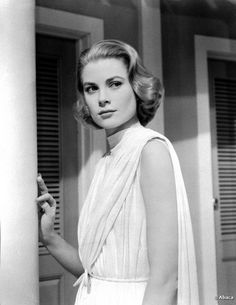 Grace Kelly: Hair - sideswept, curled and set. Perfect.