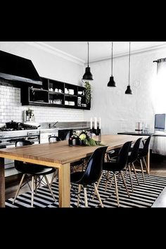From readdress, cool black and white kitchen. Love the white walls!