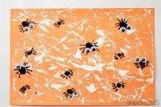 Spider web sensory craft for kids. marble paint web, thumb print spiders, google eyes