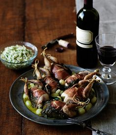 Roast quail wrapped in vine leaves with grapes and herbed orzo