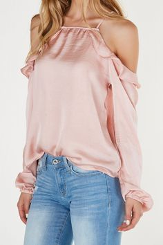 Flirty cold shoulder top with ruffle detailing. Relaxed fit with satin finish.