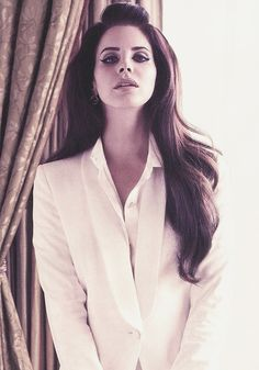 Lana Del Rey is such a siren with her long hair and her signature pout, she even makes a plain white shirt look sexy! x