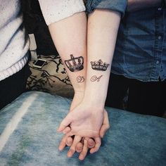 couple crown tattoos on forearms