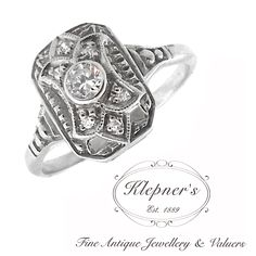 ART DECO INSPIRED PLAQUE ENGAGEMENT RING. This Art Deco inspired nine stone geometric plaque ring can be customized to include any combination of diamonds and/or gemstones such as sapphires, rubies, emeralds, birthstones, anniversary stones, etc & can be crafted in 9ct or 18ct white, rose or yellow gold, platinum or sterling silver.  Prices vary depending on your unique specifications, please don't hesitate to contact us for a quote tailored for you. Visit us at www.klepners.com.au
