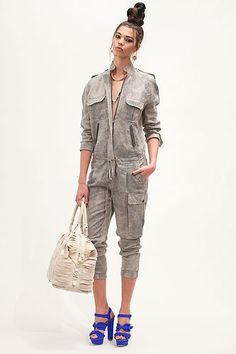 not the biggest fan of the jumpsuit... but love the purse & shoes <3