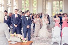 Groom sees bride at Highcliffe Castle wedding. Photography by one thousand words wedding photographers