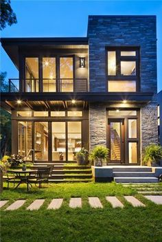 Exterior. Lake Calhoun Modern Organic. The home's graceful contemporary exterior features natural stone, corten steel, wood and glass—all in perfect alignment with the site.